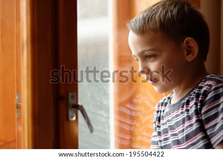 small boy near window - stock photo