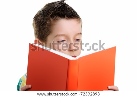 Small boy reading a book on a white background