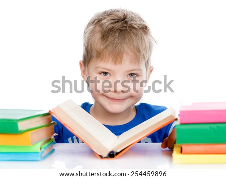 small boy reading books. isolated on white background