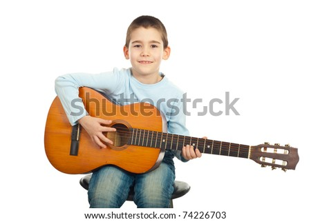 Small boy sitting on chair and playing acoustic guitar isolated on white background