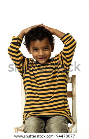 small boy sitting, portrait on a white background
