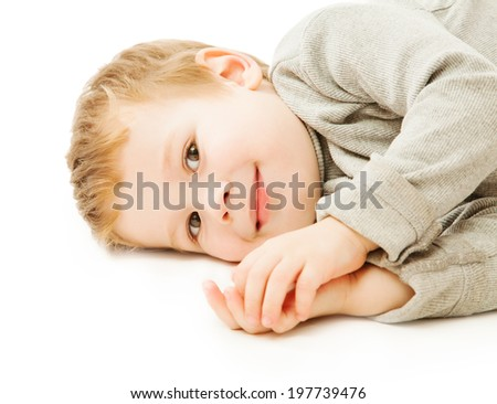 Small boy smiling over white background