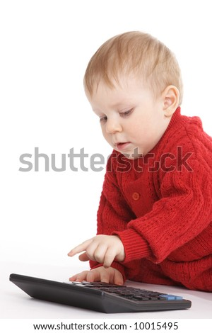 small boy studies to count with calculator - stock photo