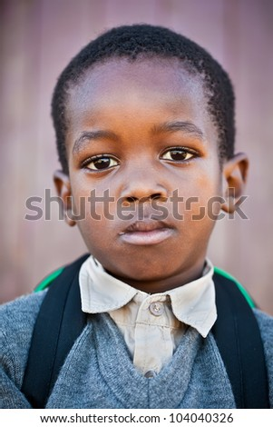 Small boy very scared to go to school for the first time. - stock photo