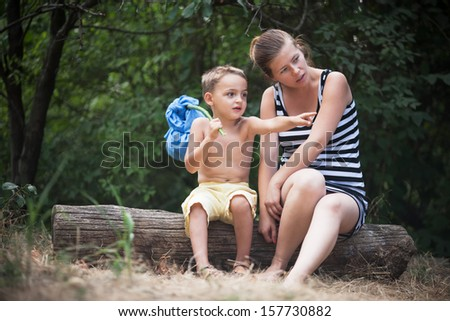 small boy with his mother - stock photo