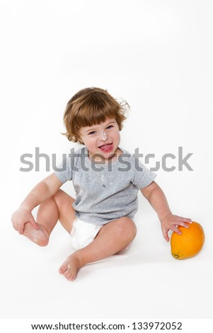 small boy with orange