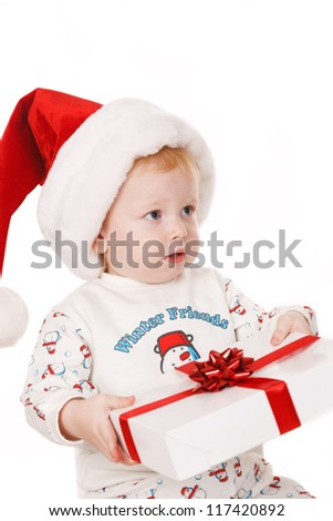 Small boy with Santa hat  holding  Christmas gift - stock photo