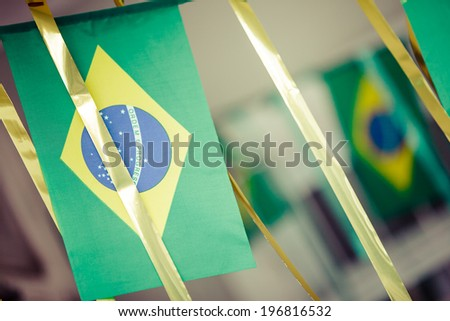 Small Brazil flags commonly used to decorate streets to support soccer cups. Instagram or vintage style. - stock photo