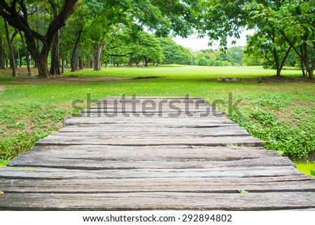 Small bridge across a stream in the park - stock photo