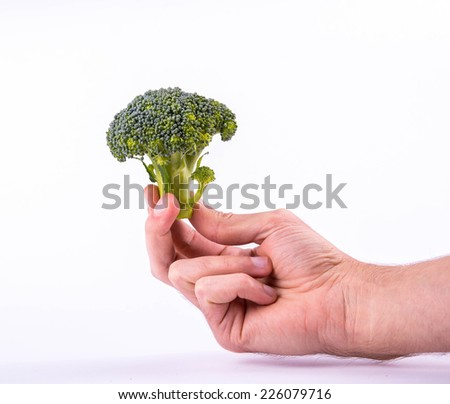 Small broccoli in a human hand