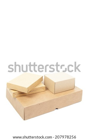 Small brown cardboard boxes stacked on top large box.on white isolated background. - stock photo