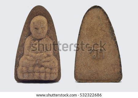 Small Buddha image amulet on white background.