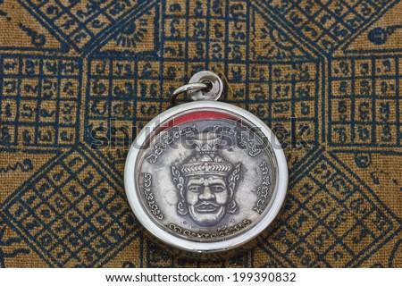 small buddha image used as amulets - stock photo
