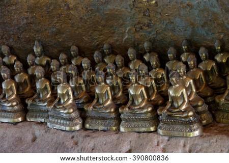 Small Buddha statues  in a shrine at  Phnom Kulen, Cambodia - stock photo
