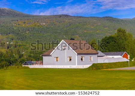 Small building on the green nature of a Summer Norway