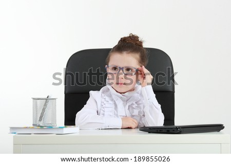Small business. Cute little girl in glasses