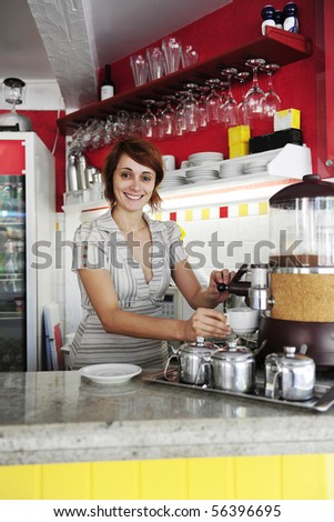 small business: female owner or waitress making coffee - stock photo