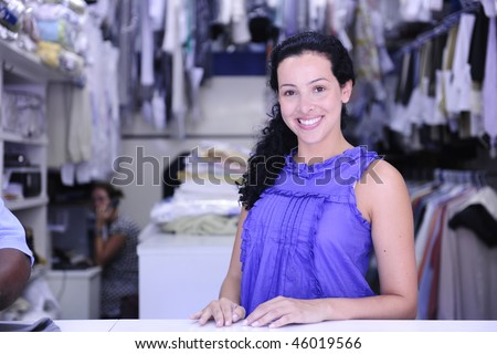 small business: happy owner of a dry cleaning service - stock photo
