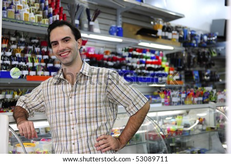 small business: happy owner of a stationery shop - stock photo