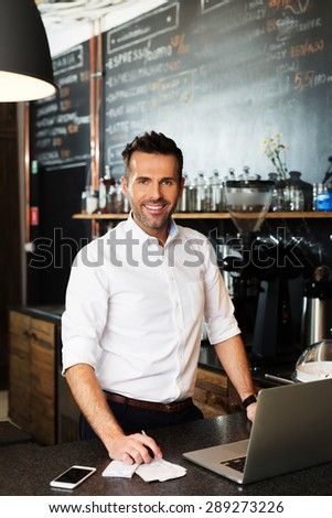 Small business owner calculating revenue - stock photo