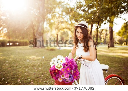 Small business owner. Girl selling flowers. Selective focus, depth of field   - stock photo