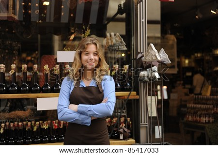 small business owner in front of store