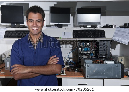 Small business:  owner of a computer repair store - stock photo