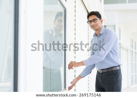 Small business owner opening his new shop in morning. - stock photo