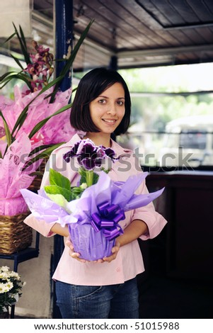 small business owner: proud woman and her flower shop - stock photo