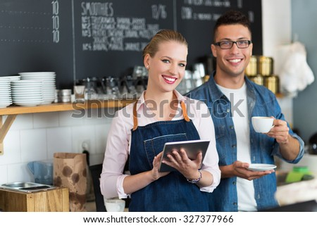 Small business owners in coffee shop - stock photo