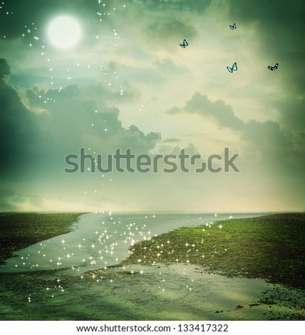 Small butterflies and moon in fantasy landscape - stock photo