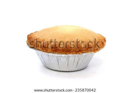Small cake tins in a foil on a white background - stock photo