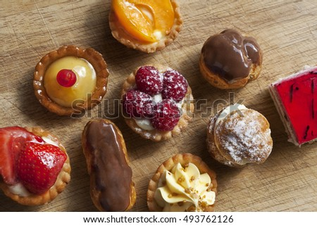 Small cakes on a wooden table in a kitchen
