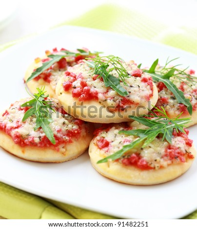 Small cakes with ham and cheese as appetizer - stock photo