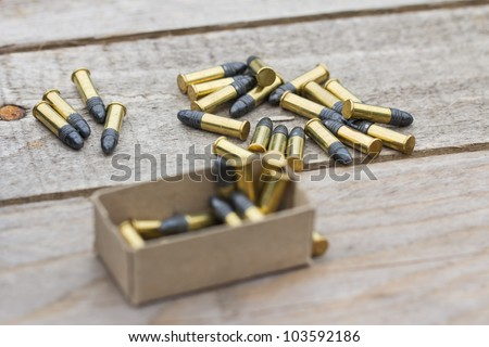 Small caliber ammunition in a pile - stock photo