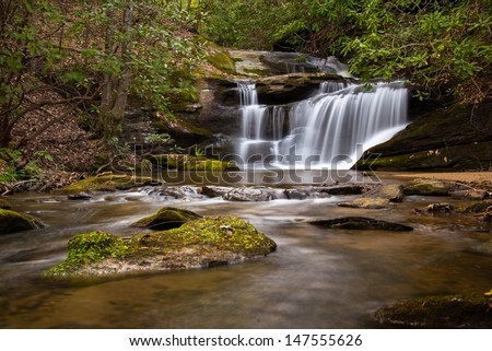 Small Cascade in the Upstate of South Carolina on Carrick Creek near Table Rock State Park - stock photo