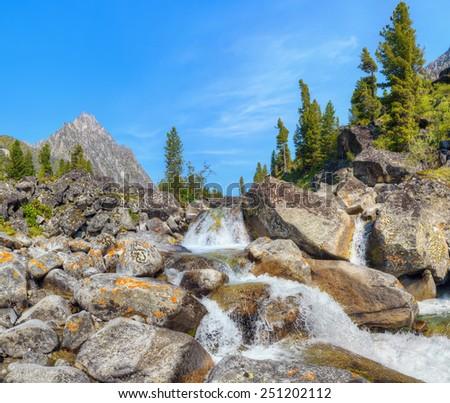 Small cascade of waterfalls on a mountain creek. Eastern Sayan. Buryatia - stock photo