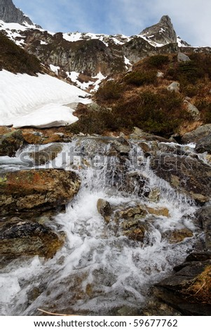 Small cascade on a mountain in the French Alps