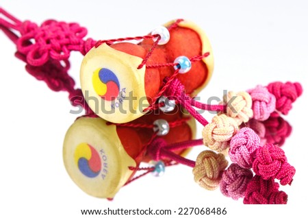 Small Changgo Drum, one the Korean souvenir on white background with reflection. - stock photo