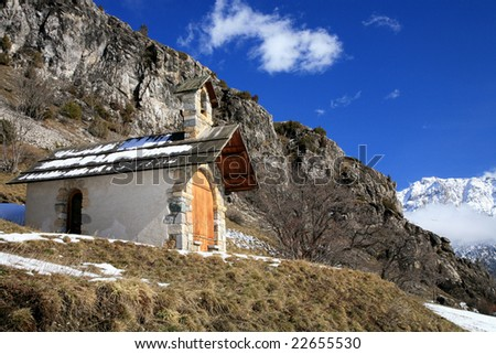 Small chapel in mountains near Nevache old village in French Alps - stock photo