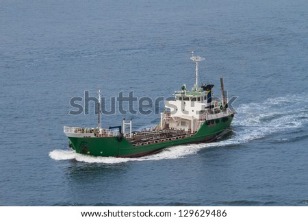 Small chemical/liquid transport ship cruises across the bay.