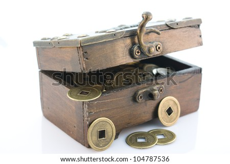 Small chest with chinese lucky coins - stock photo