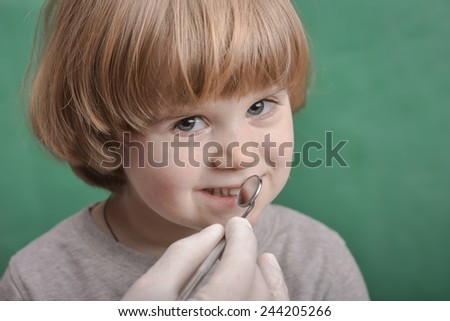 Small child at the dentist office  - stock photo