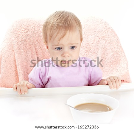 Small child does not want to eat children's porridge - stock photo