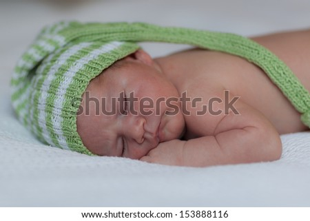 Small child dreaming and wearing cap - stock photo