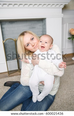 small child in the arms of mom . positive human emotions, feel
