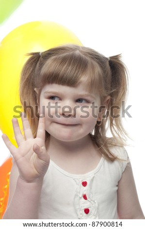 small child looking away from camera is holding 4 fingers up indicating her age