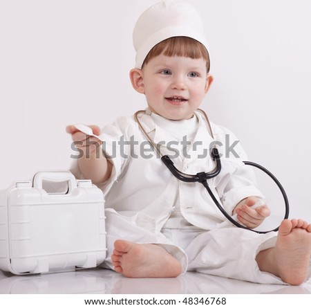 Small child play hospital and doctor - stock photo