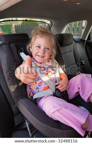 Small child seated in child seat in the car