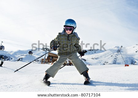 Small child skiing in French resort